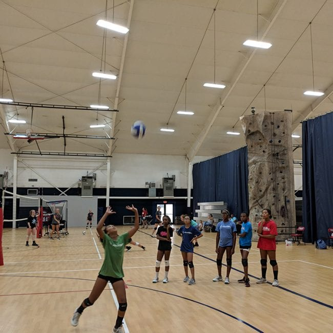 Young Girls learning how to volleyball set