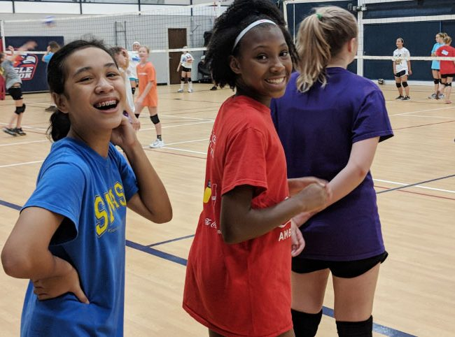 Students smiling during volleyball practice