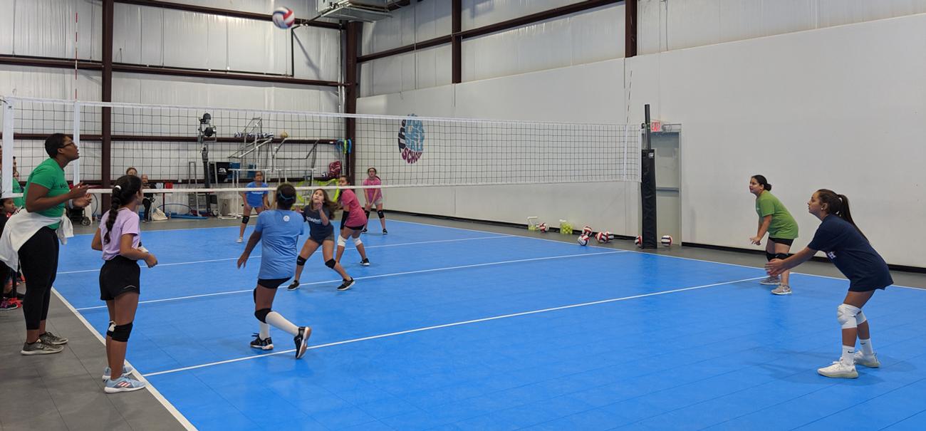 Volleyball School Coach teaching drills