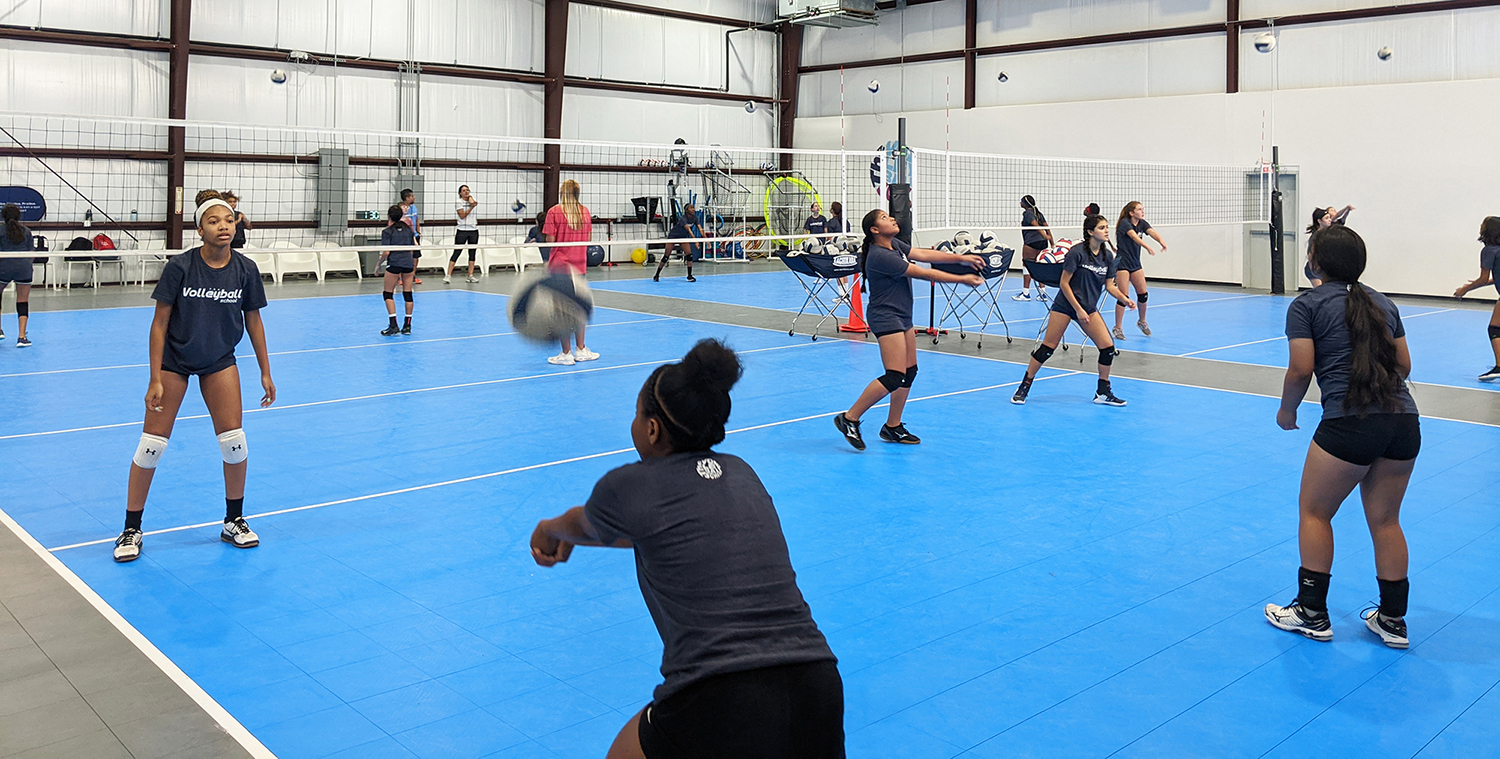 Group of girls training volleyball at the volleyball school